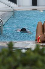 CLAUDIA ROMANI in Bikini at a Pool in Miami 11/13/2016