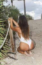 CLAUDIA ROMANI in Swimsuit at a Beach in Miami 11/05/2016