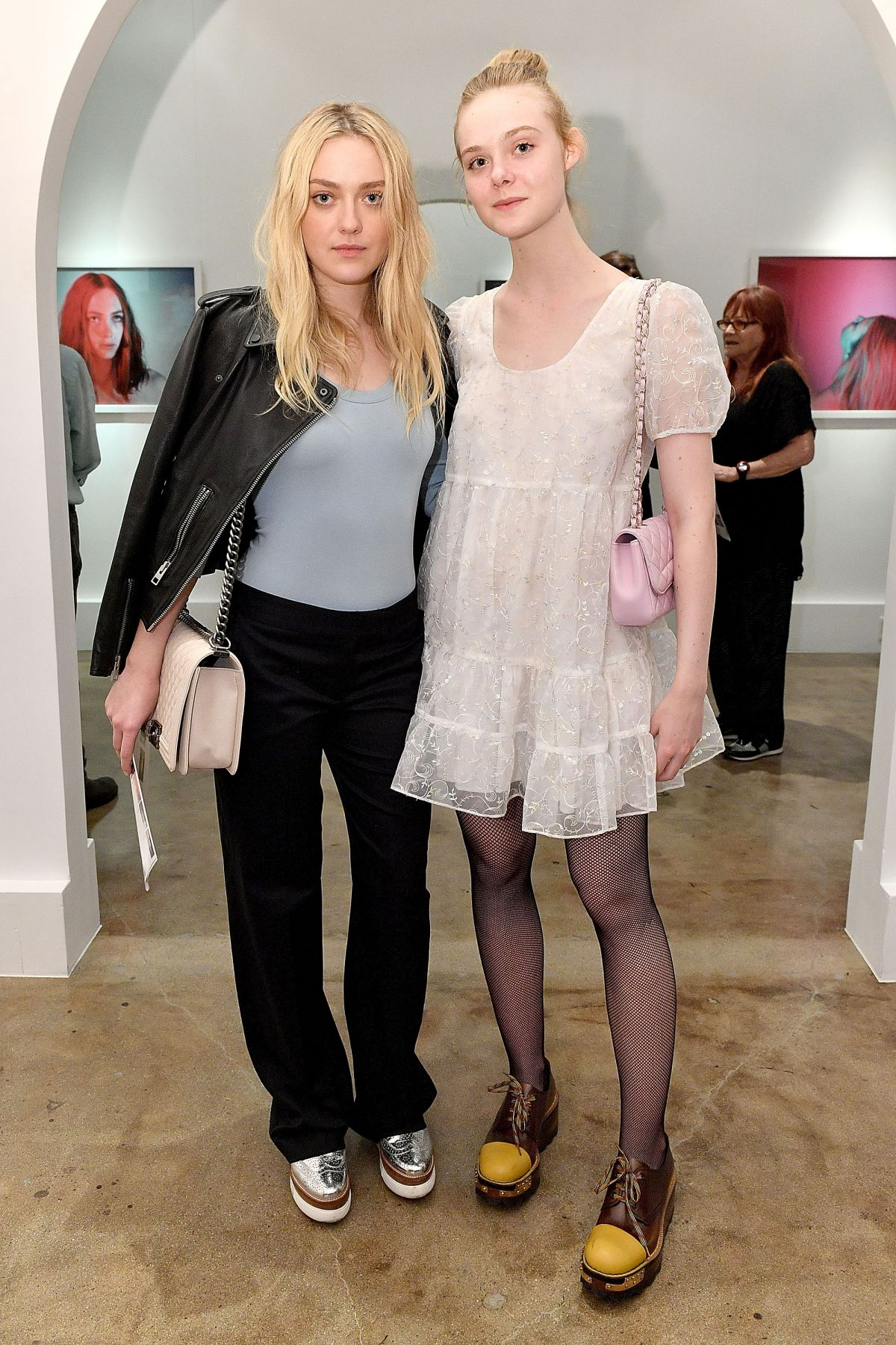 DAKOTA and ELLE FANNING at Anton Yelchin Photography Exhibit Opening in Los Angeles 11/05/2016