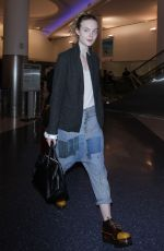 ELLE FANNING at Los Angeles International Airport 11/04/2016