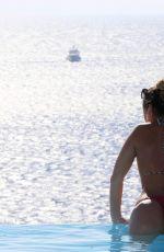 LAURYN GOODMAN in Bikini at a Pool in Mykonos 11/19/2016