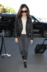 LILY COLLINS Arrives at Los Angeles International Airport 11/21/2016