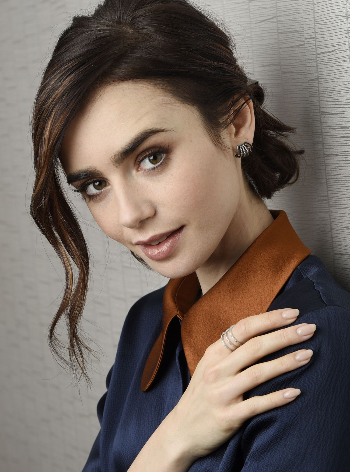 LILY COLLINS by Chris Pizzello fot The Associated Press, November 2016