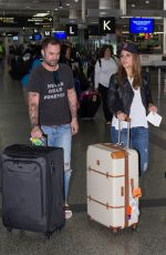 MARIA MENOUNOS at Tullamarine Airport in Melbourne 11/02/2016
