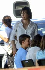 MILLA JOVOVICH on the Set of 'Shock and Awe' in New Orleans 10/31/2016