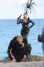 NATASHA POLY in Vinyl Outfit at a Photoshoot in Miami Beach 11/03/2016