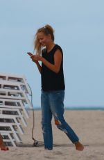 NATASHA POLY on the Set of a Photoshoot on the Beach in Miami 11/03/2016