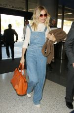 SIENNA MILLER at Los Angeles International Airport 11/17/2016