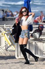 BELLA THORNE in Jeans Shorts Out on the Beach in Miami 12/18/2016