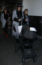 CHRISSY TEIGEN at LAX Airport in Los Angeles 12/16/2016