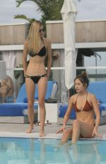DANIELLE KNUDSON and JOCELYN CHEW at a Pool in Miami 12/03/2016