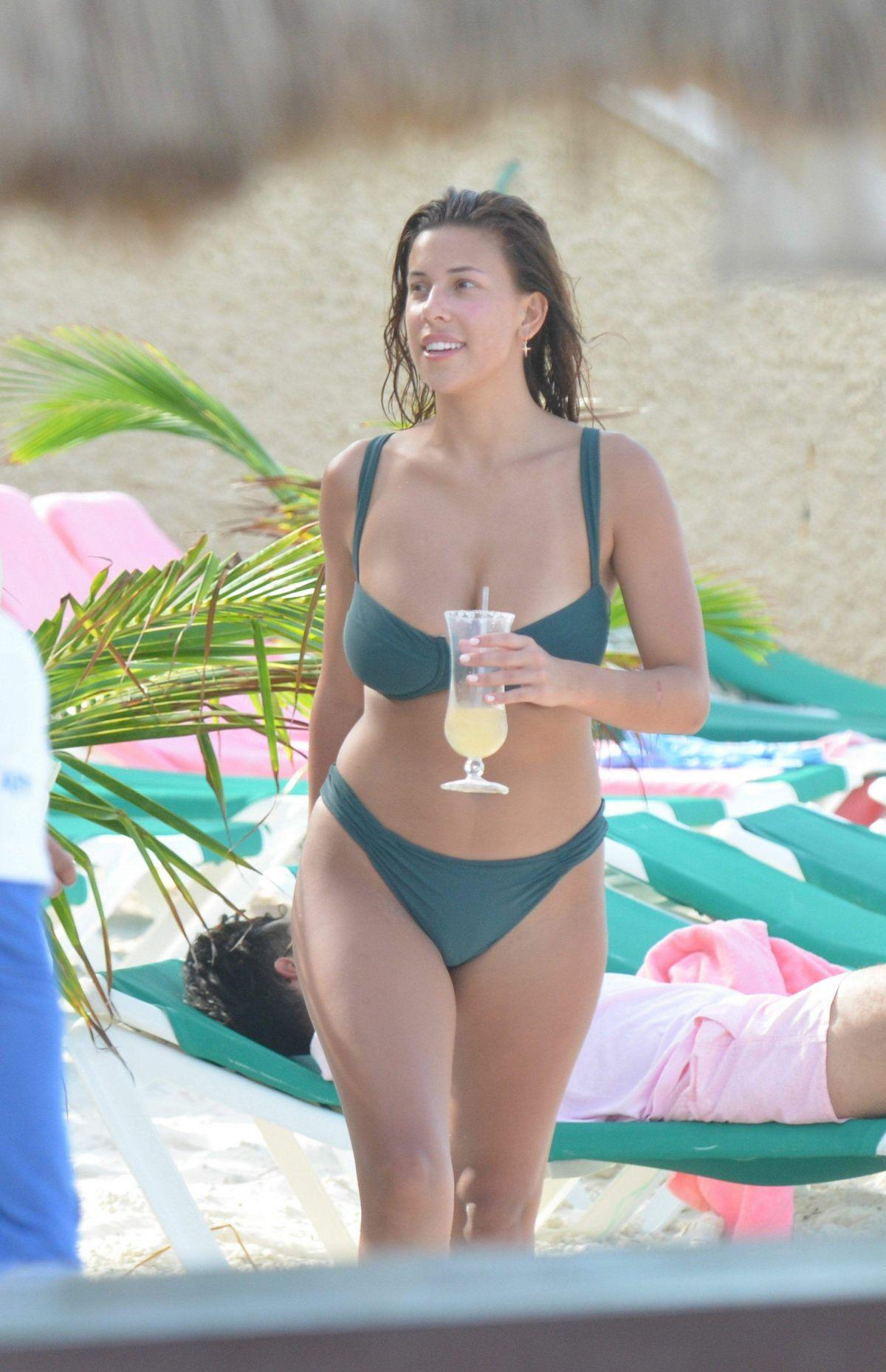 DEVIN BRUGMAN in Bikini on the Beach in Cancun 12/15/2016