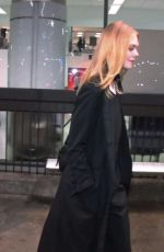 ELLE FANNING at LAX AIrport in Los Angeles 12/15/2016
