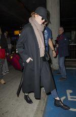 EMMA STONE Leaves Heathrow Airport in London 12/13/2016