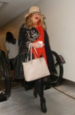 JENNIFER COOLIDGE at LAX Airport in Los Angeles 12/20/2016