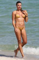 KELLY BENSIMON in Gold Bikini in Miami Beach 12/28/2016