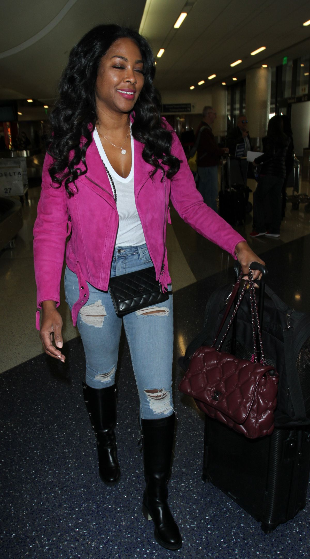 KENYA MOORE at LAX Airport in Los Angeles 12/14/2016