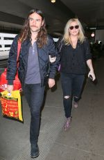 KESHA and Her Boyfriend Brad Ashenfelter at LAX Airport 12/21/2016