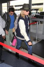 KIM BASINGER at LAX Airport in Los Angeles 12/05/2016