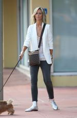 LADY VICTORIA HERVEY Walks Her Dog Out in Miami 11/30/2016