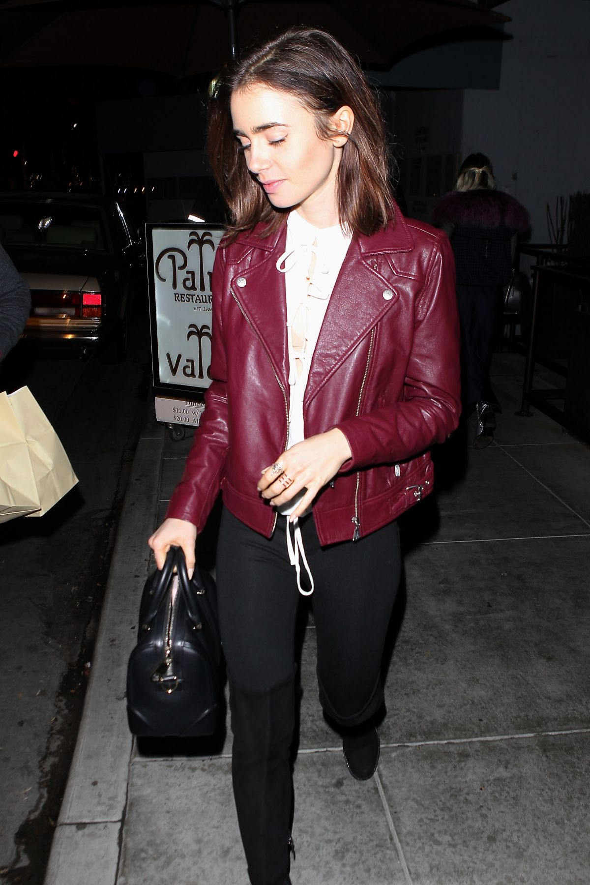 LILY COLLINS Leaves The Palm in Beverly Hills 12/15/2016
