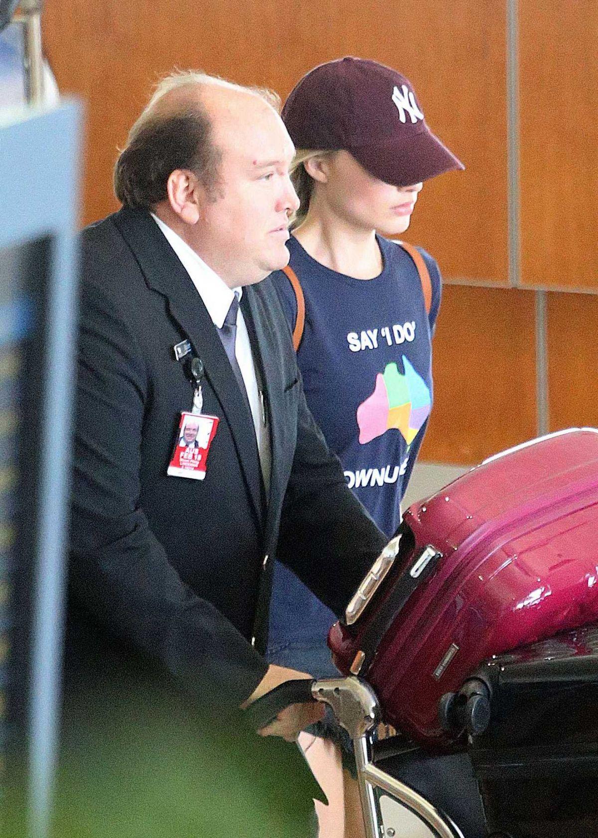 MARGOT ROBBIE at Airport in Brisbane 12/20/2016