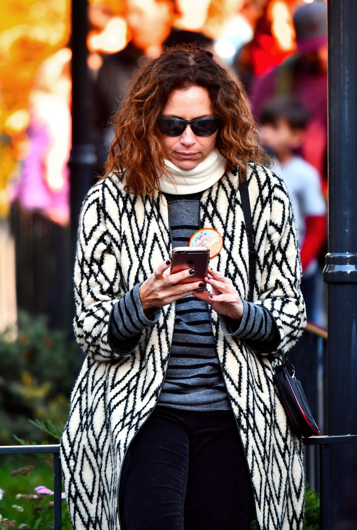 MINNIE DRIVER Out in Disneyland in Anaheim 12/23/2016