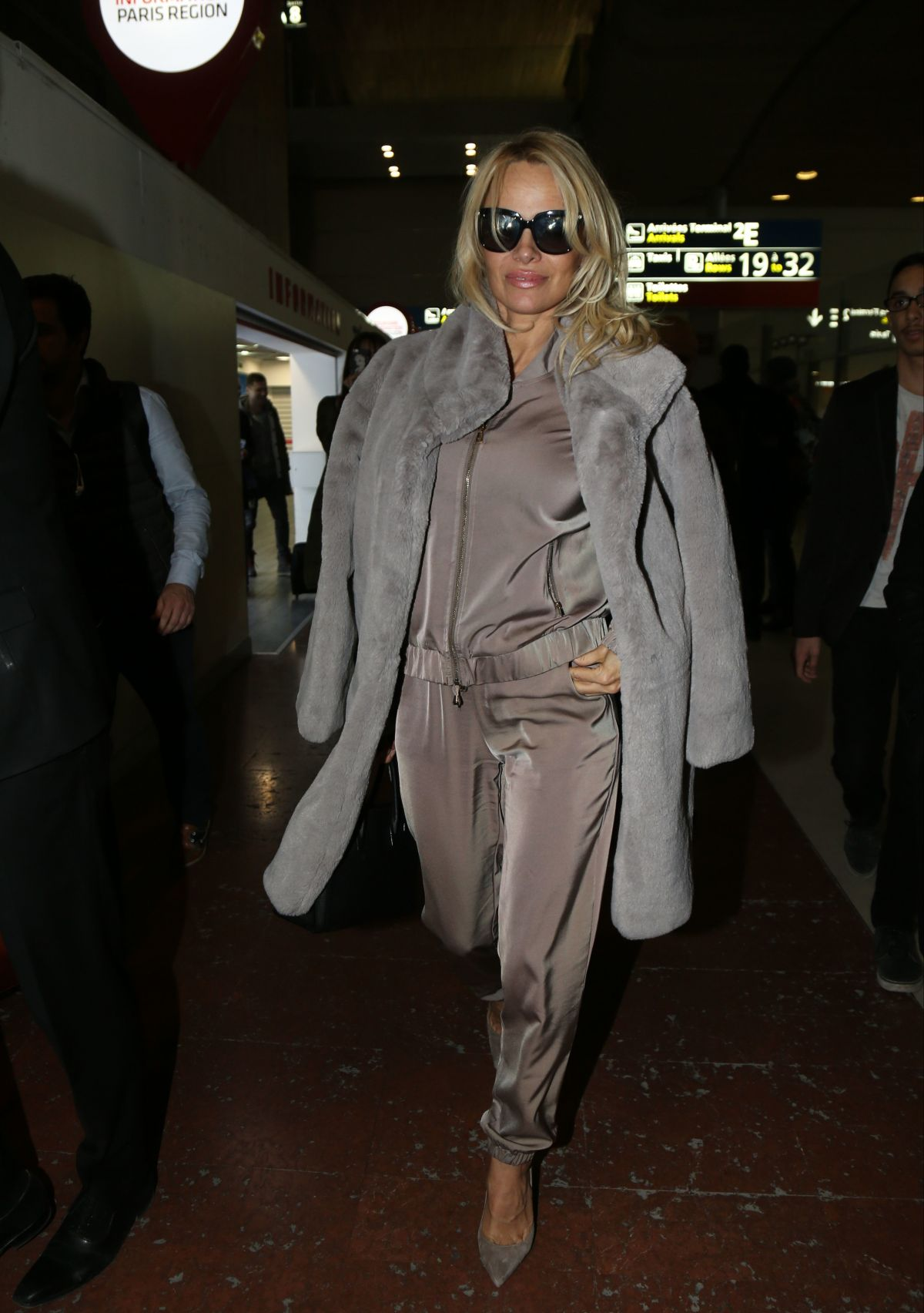 PAMELA ANDERSON at Charles De Gaulle Airport in Paris 12/17/2016