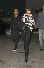 CHRISSY TEIGEN and John Legend at LAX Airport in Los Angeles 01/06/2017