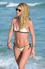 DOUTZEN KROES and JOAN SMALLS in Bikini on the Beach in Miami 01/01/2016