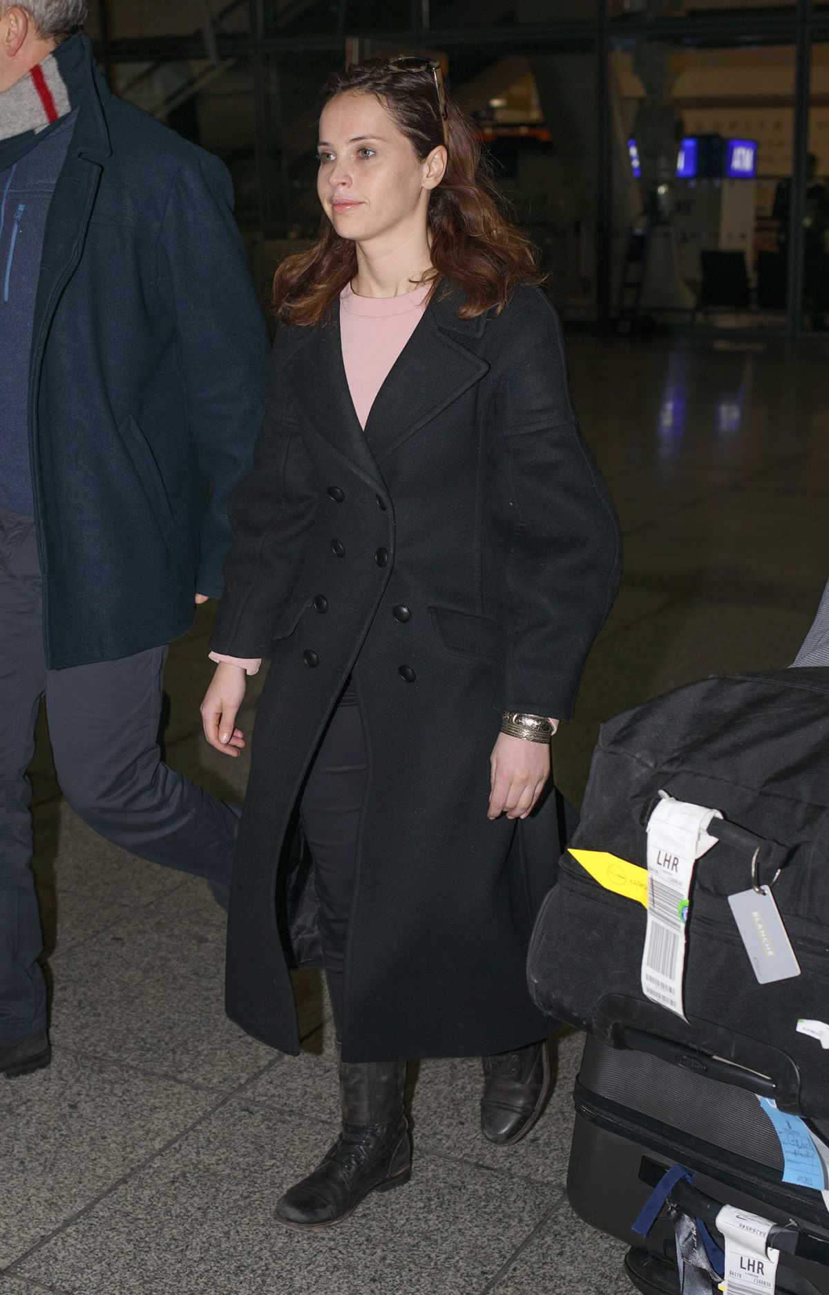 FELICITY JONES Arrives at Heathrow Airport in London 01/16/2017