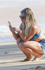 HILARY DUFF in Daisy Dukes and Bikini Top on the Beach in Hawaii 01/02/2017