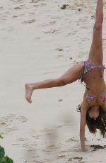 IZABEL GOULARD in Bikini Doing Gymnastic on the Beach in St. Barts 12/31/2016