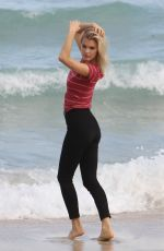 JOY CORRIGAN on the Set of a Photoshot on the Beach in Miami 01/15/2017