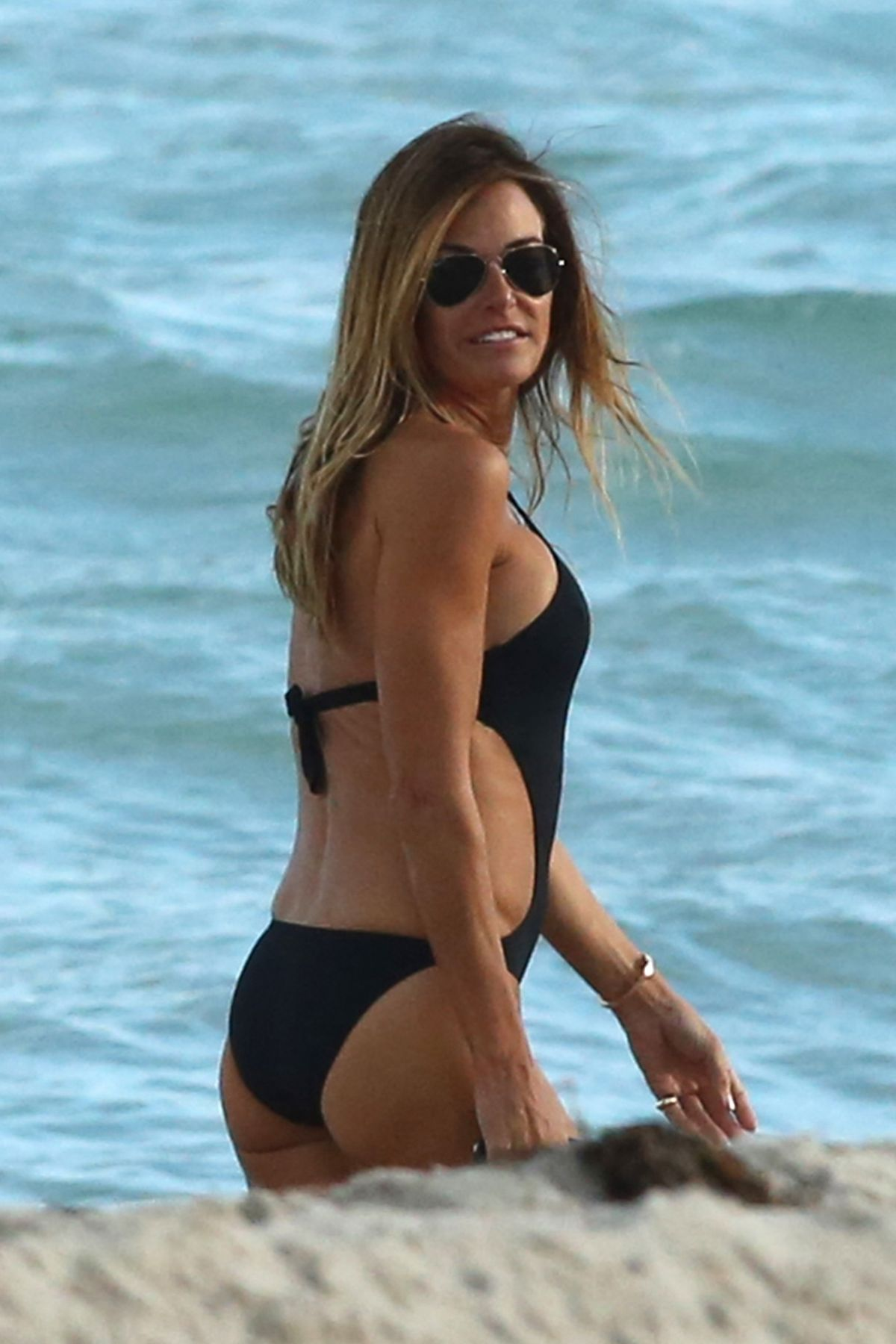 KELLY BENSIMON in Bikini at a Beach in Miami 01/06/2017