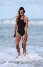 KELLY BENSIMON in Swimsuit on Miami Beach 01/14/2017