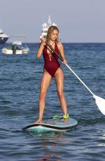 KIMBERLEY GARNER in Swimsuit Paddleboarding in San Tropez 01/04/2017