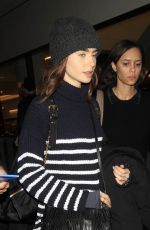 LILY COLLINS at LAX Airport in Los Angeles 01/23/2017