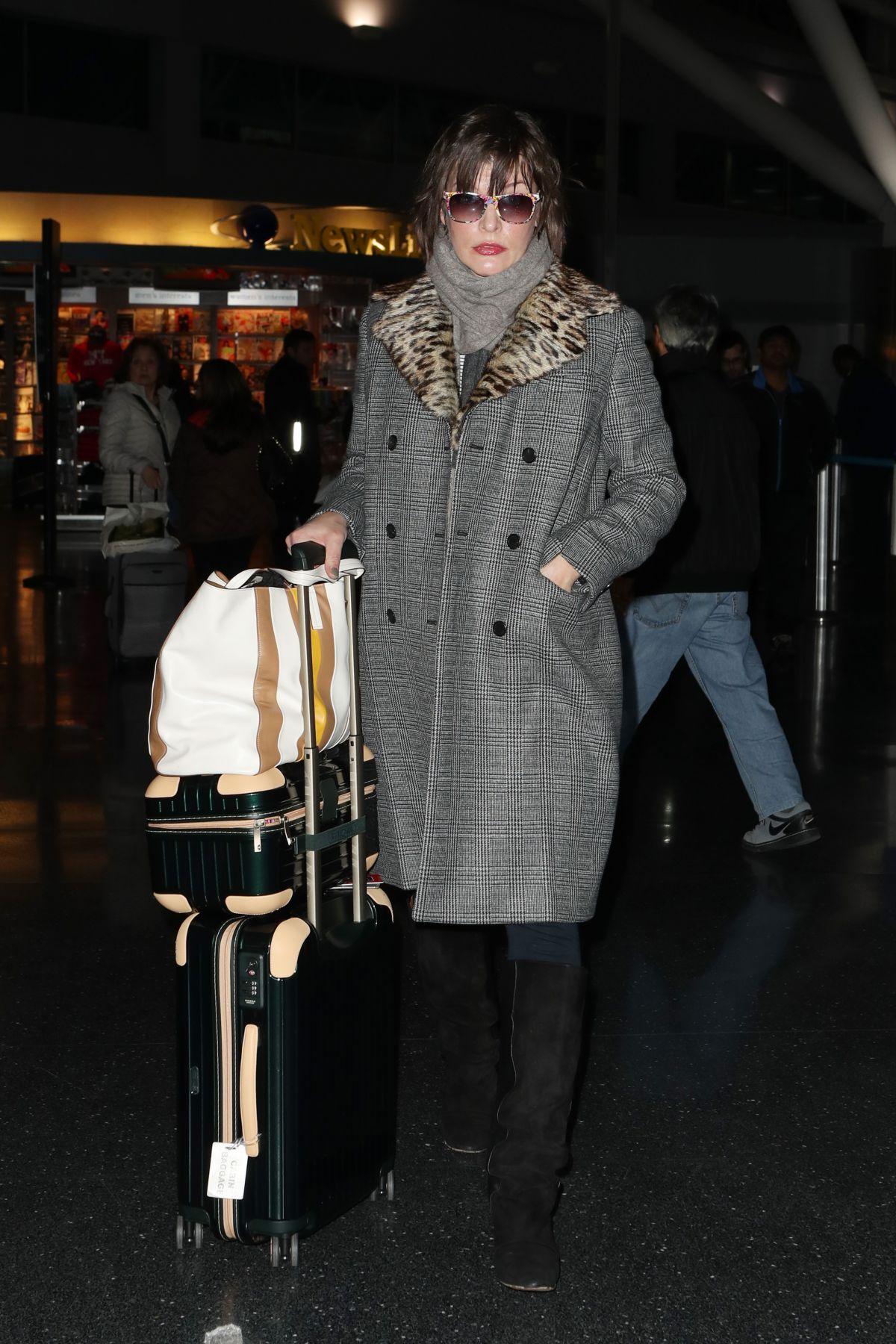 MILLA JOVOVICH at Los Angeles International Airport 01/25/2017