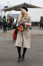 PAMELA ANDERSON at a Refugee Camp in Grande-synthe 01/25/2017