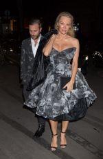PAMELA ANDERSON Leaves Four Seasons George V Hotel in Paris 01/27/2017