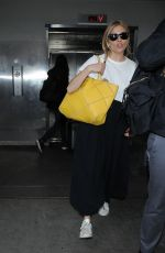 SIENNA MILLER Arrives at LAX Airport in Los Angeles 01/05/2017