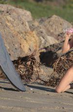 AMANDA GEORES in Bikini on the Set of a Photoshoot for 138 Water in Malibu 02/24/2017