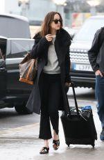 DAKOTA JOHNSON at Heathrow Airport in London 02/10/2017