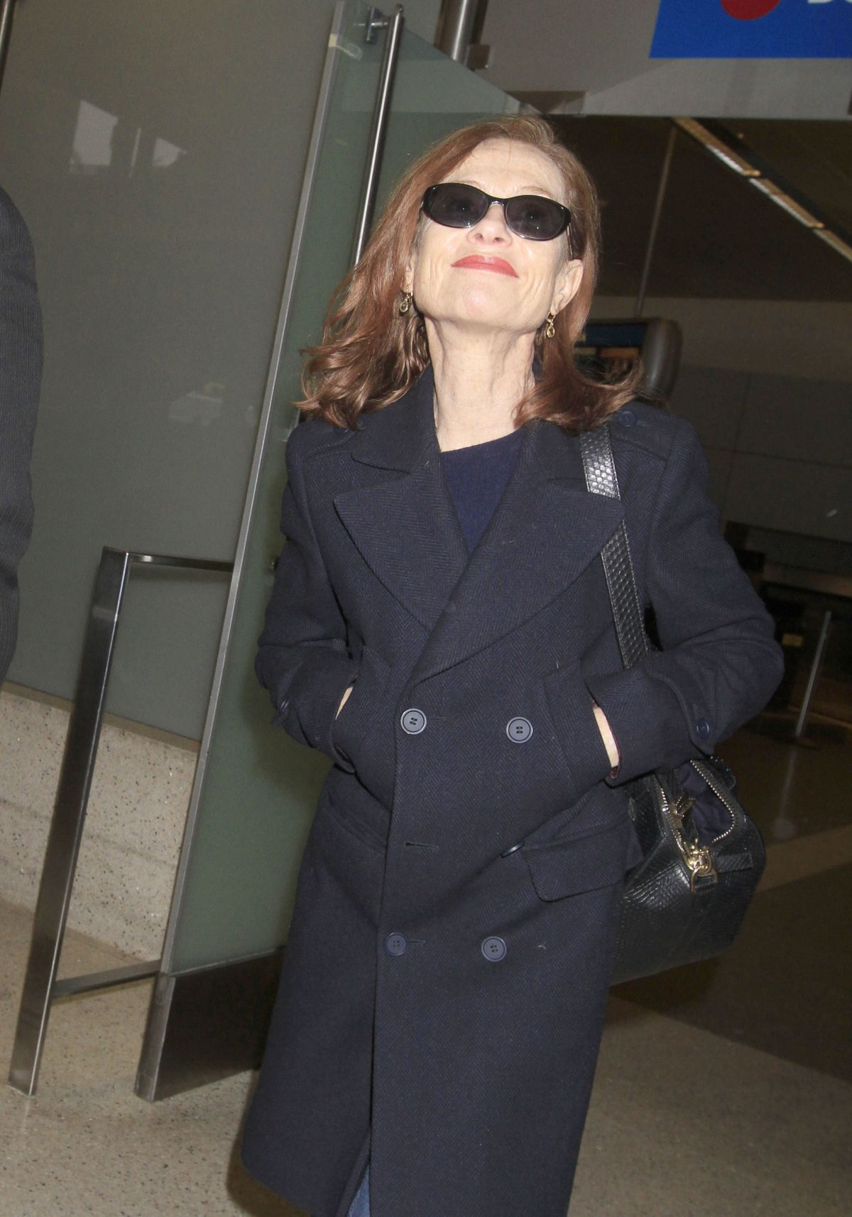 ISABELLE HUPPERT at LAX Airport in Los Angeles 02/03/2017