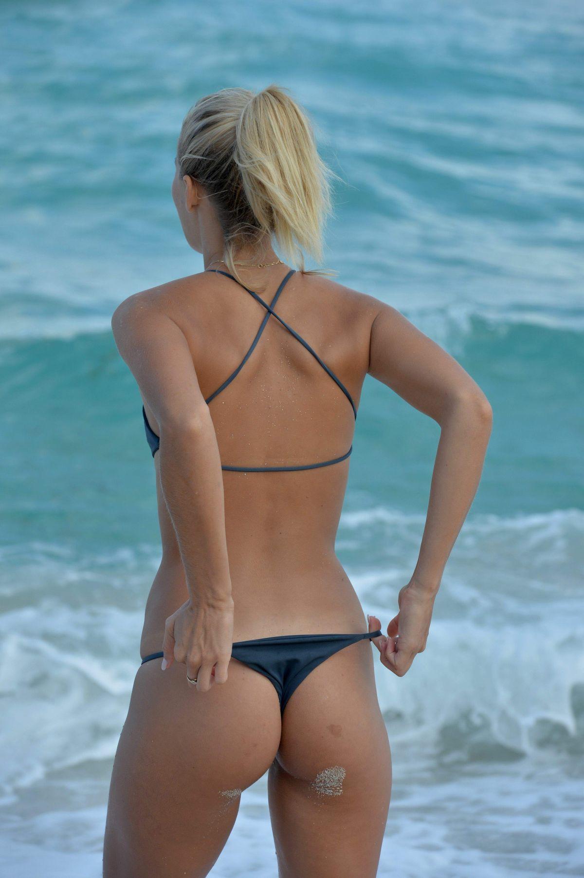 Michelle Hunziker Nipslip And Bikini Beach Photos