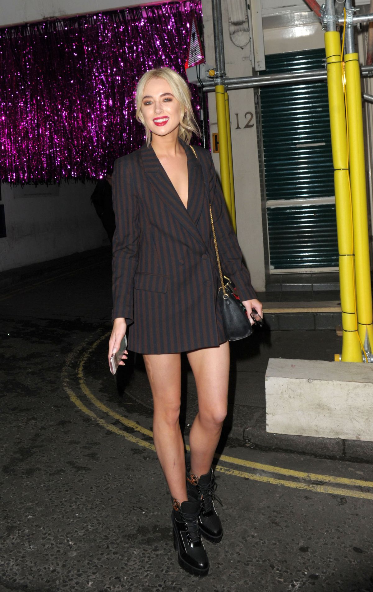 NICOLA HUGHES Leaves Maybelline Party in London 02/18/2107