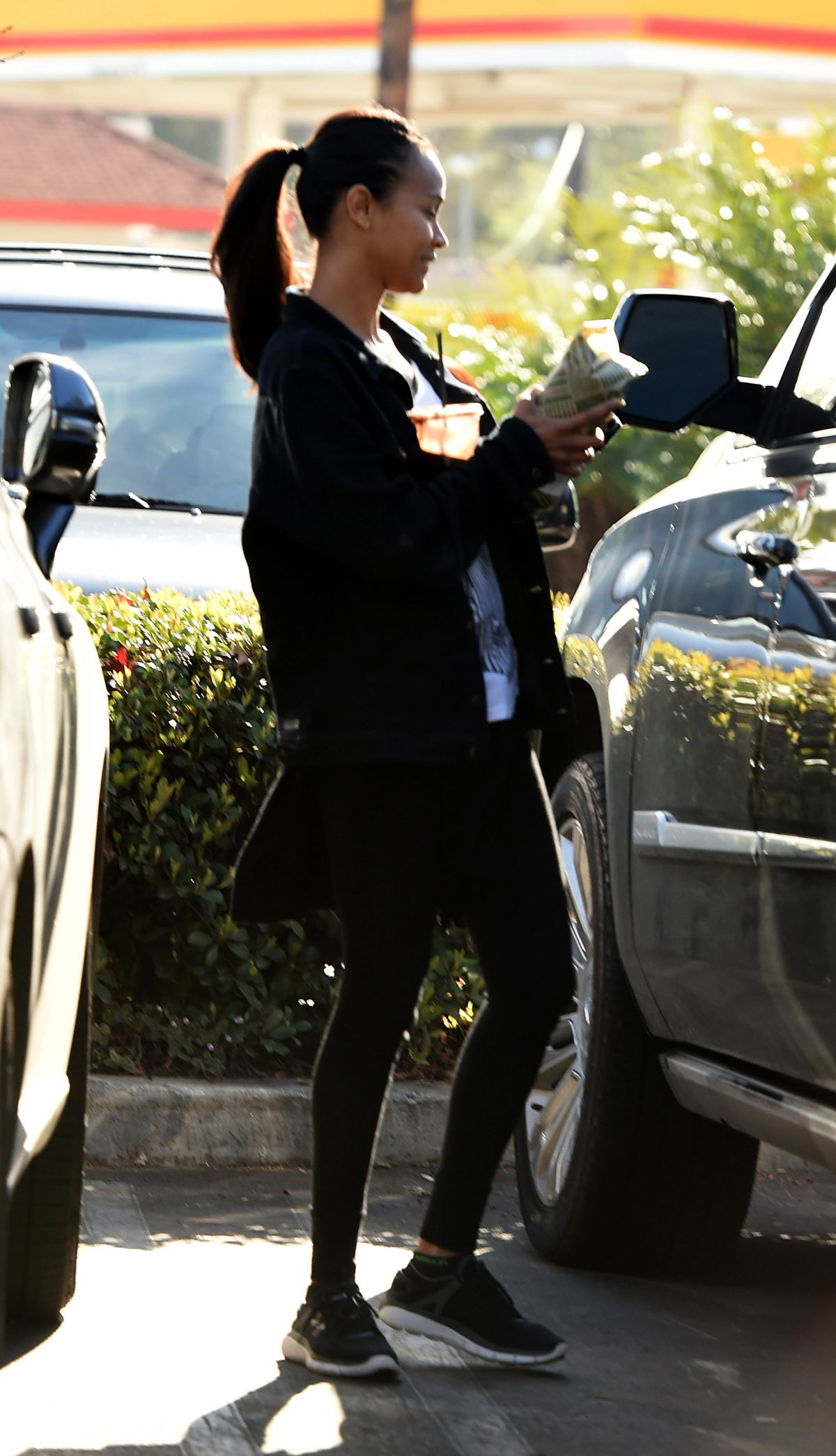 ZOE SALDANA in Tight Out in Los Angeles 02/14/2017