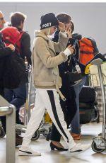 CARA DELEVINGNE at Charles De Gaulle Airport in Paris 03/20/2017