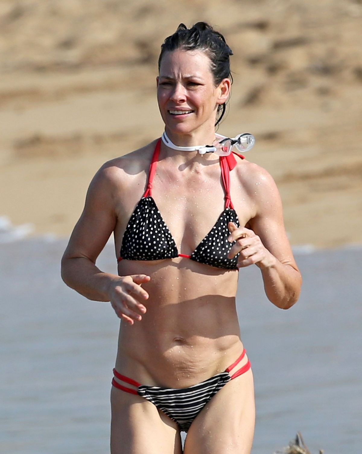 EVANGELINE LILLY in Bikini at a Beach in Hawaii 02/28/2017